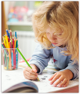 Child Coloring With Colored Pencils